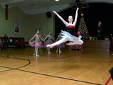 The 2013 Holiday Party at Primoris Academy had a Nutcracker Suite theme and included entertainment by an outside ballet troupe in addition to catered food and fun activities for the whole family.