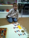 The classic Montessori work called the moveable alphabet helps the child in his or her exploration and analysis of a known language.  It allows the child to reproduce words with symbols (i.e. letters).  It also gives the child a new way to communicate (the written word).  This prepares the child for both writing and reading.
