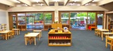 Our open classroom design is geared toward a child sized world with work areas both inside and out.
