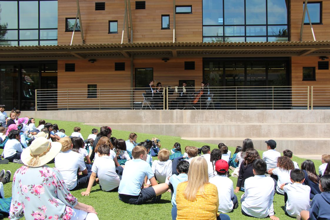 Belmont Oaks Academy Photo - A string quartet performs for elementary students on the porch of the lower elementary building.