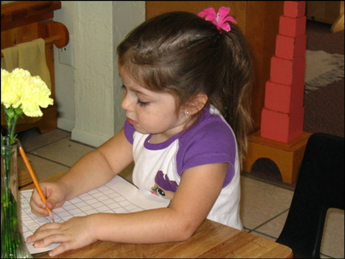 Montessori International School Photo - Practicing writing in the MIS primary class.