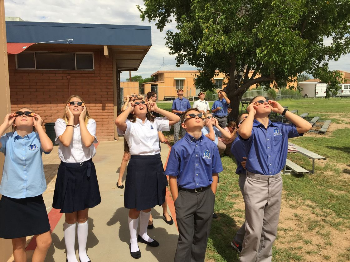 Wickenburg Christian Academy Photo #1 - WCA students used special glasses that were donated so they could experience the Solar Eclipse in what may be a once-in-a-lifetime event. Now, there's a bright idea!