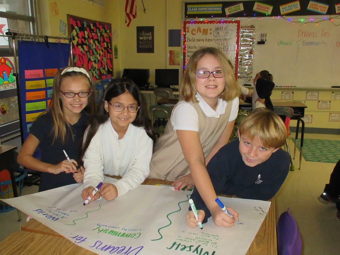 Nativity Catholic School Photo #1 - Third grade students work on writing dreams for themselves, their community, and the world