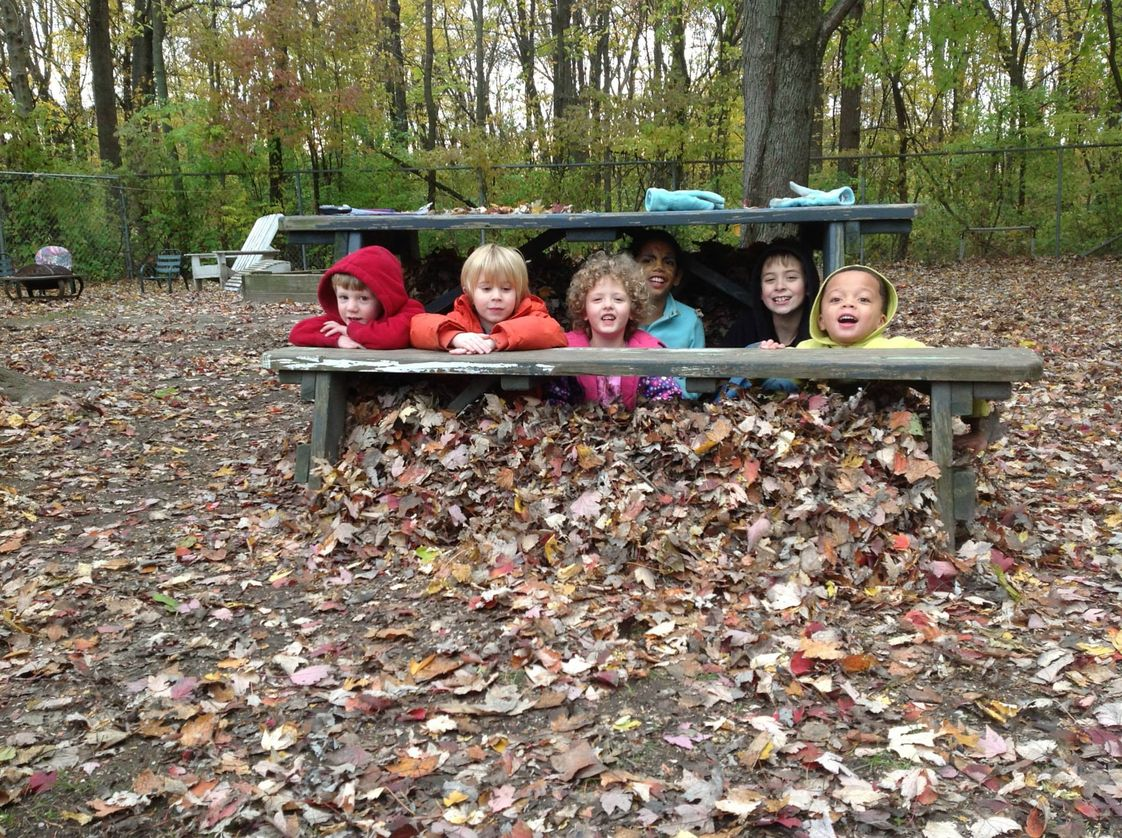 The Childrens House Photo #1 - Leaf fort!! Hiding out with Isa, Liam, Riley, Fisher, Eva, and Teo!