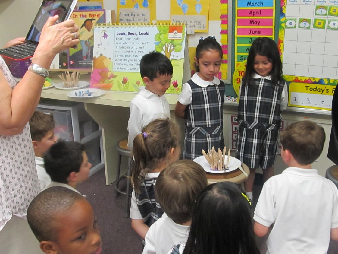 Saint Peter's School Photo #1 - Kindergarten students testing their Structure & Function STEM project-designing a house for the Three Little Pigs