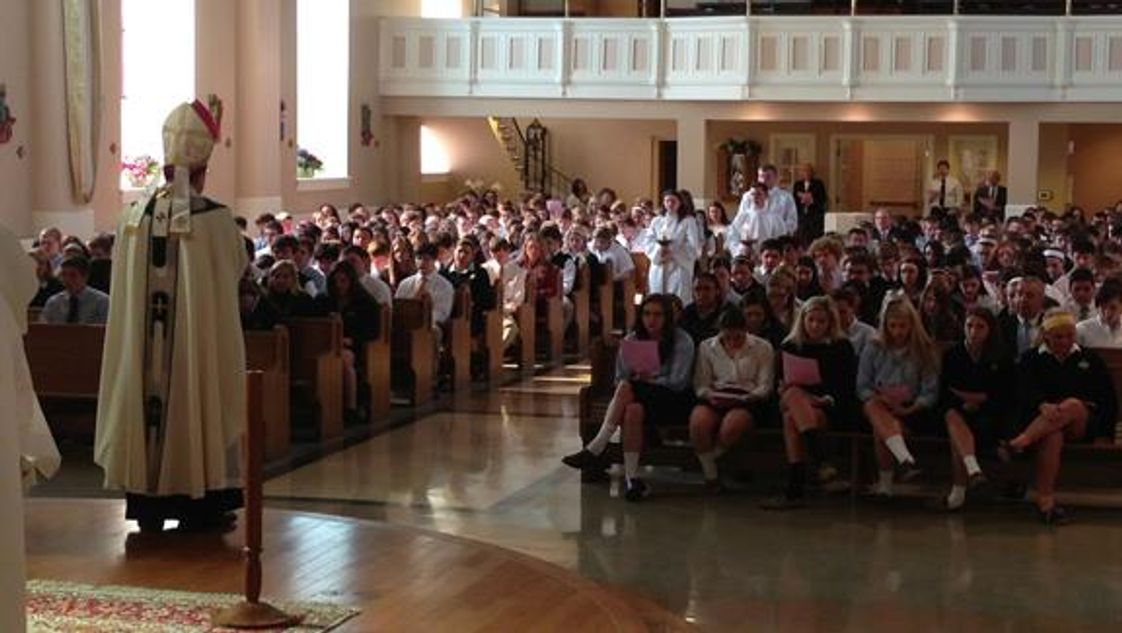 St Mary Catholic Central High School Photo - Living Faith- Students sharing mass with Archbishop Vigneron.