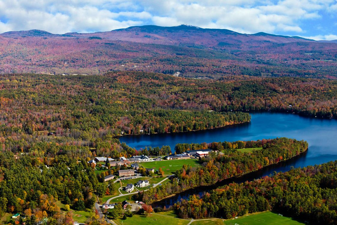Cardigan Mountain School Photo - An autumn aerial view of the Cardigan campus with its mountain namesake in the distance.