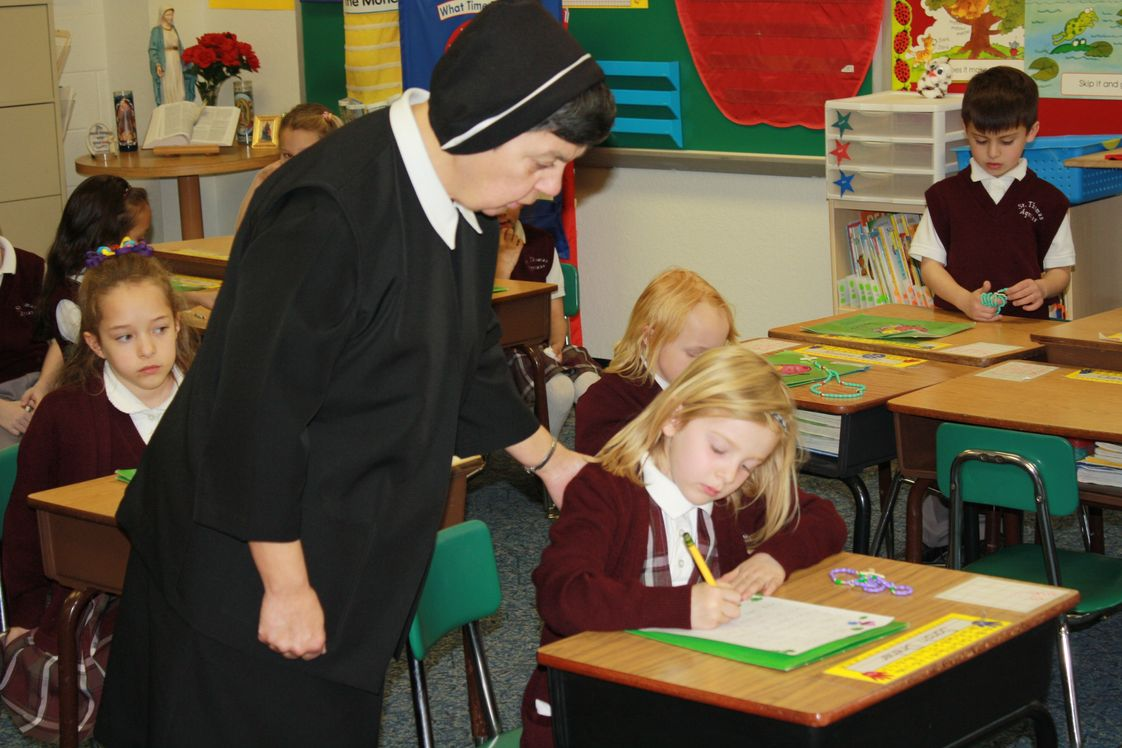 St. Thomas Aquinas School Photo - Sister Anne Louise spends instructional time with STAS 1st grade class.
