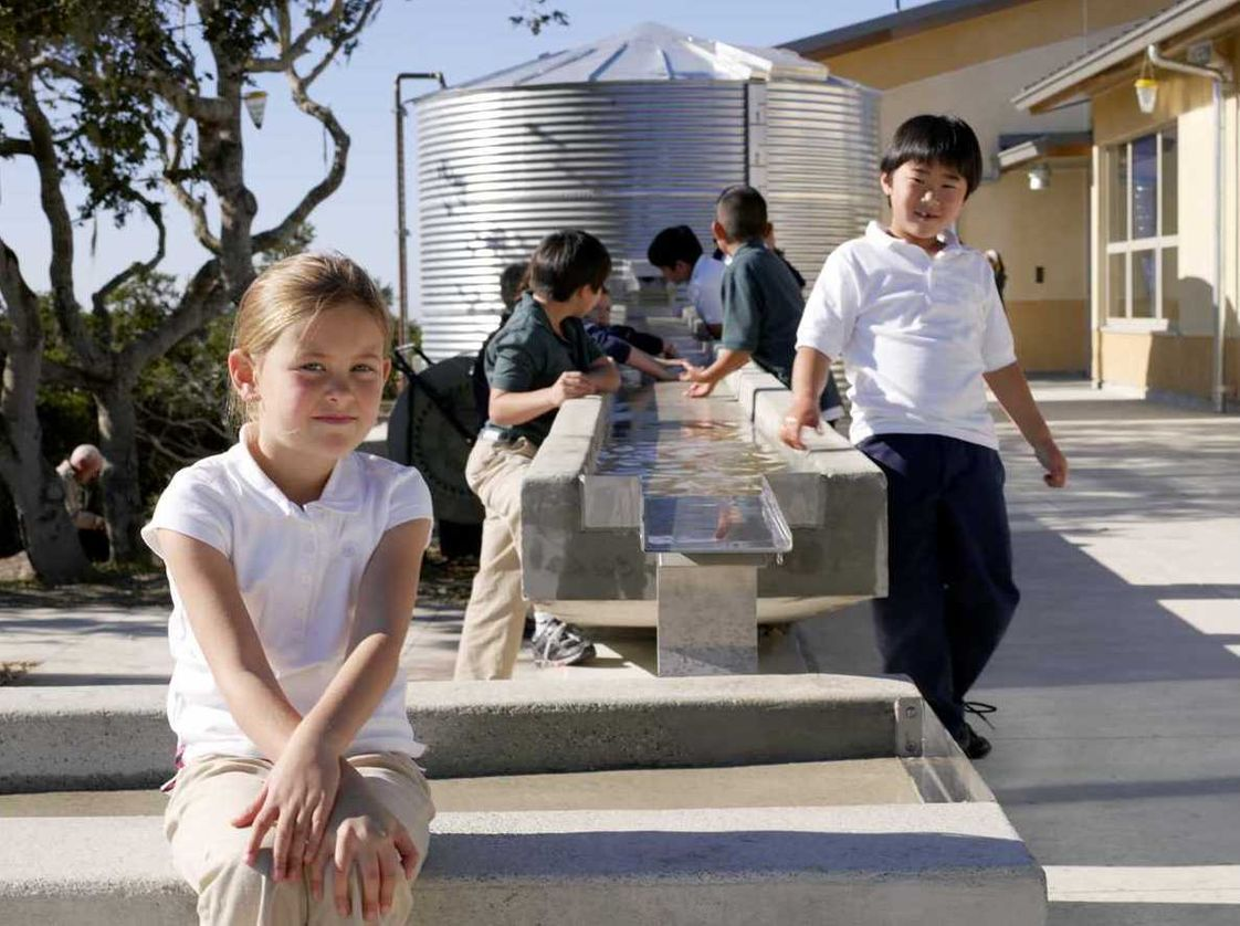 Chartwell School Photo - The green campus serves as a teaching tool. Here, students in science class learn about the rain catchement system and cistern, which collect water for flushing toilets, watering the field, and watering the student garden.