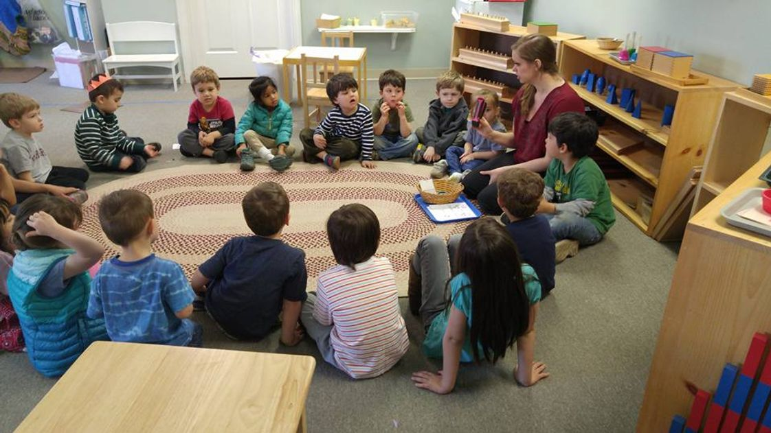 Pinewoods Montessori School Photo #1 - The toddlers sit in circle time with their teacher, Miss Brandy.