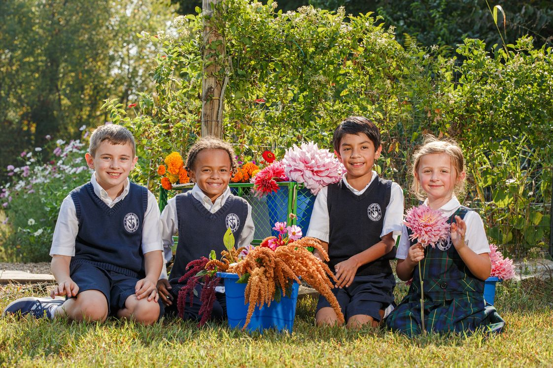 St. Mary School Photo - Our school flower garden allows us to get outside occasionally, soak in some sunshine, and get our hands dirty!