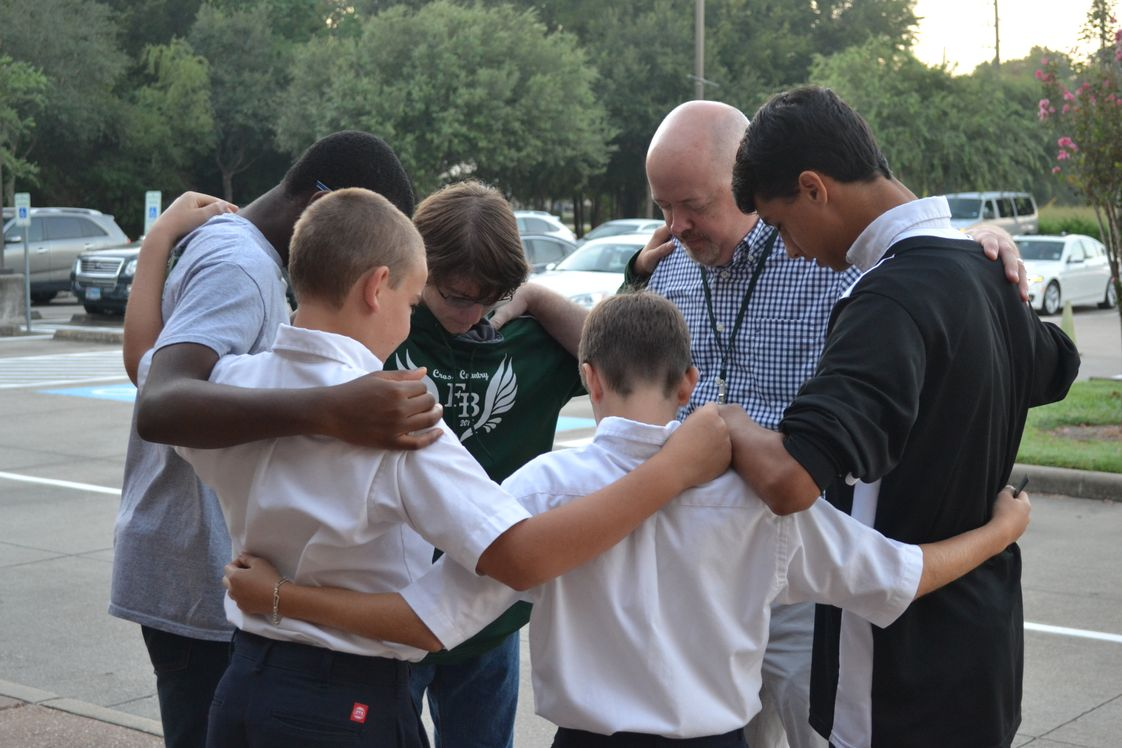 Fort Bend Christian Academy Photo - Teachers and students gather to pray at the annual See You at the Pole event. Along with academic standards, the goals of the school are to exalt Jesus Christ as students learn to love God with all their heart, soul, mind, and strength; to love others as themselves; and to learn to serve God first.