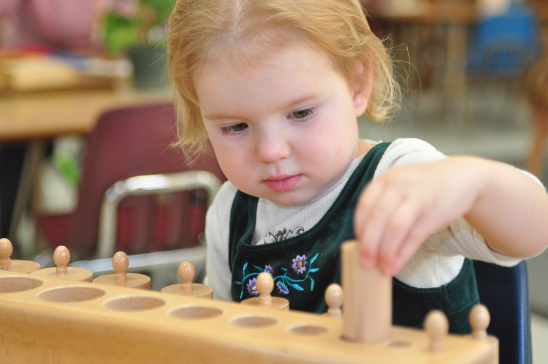 Montessori Of Brea Photo #1 - 2 year old working with the Cylinder Blocks