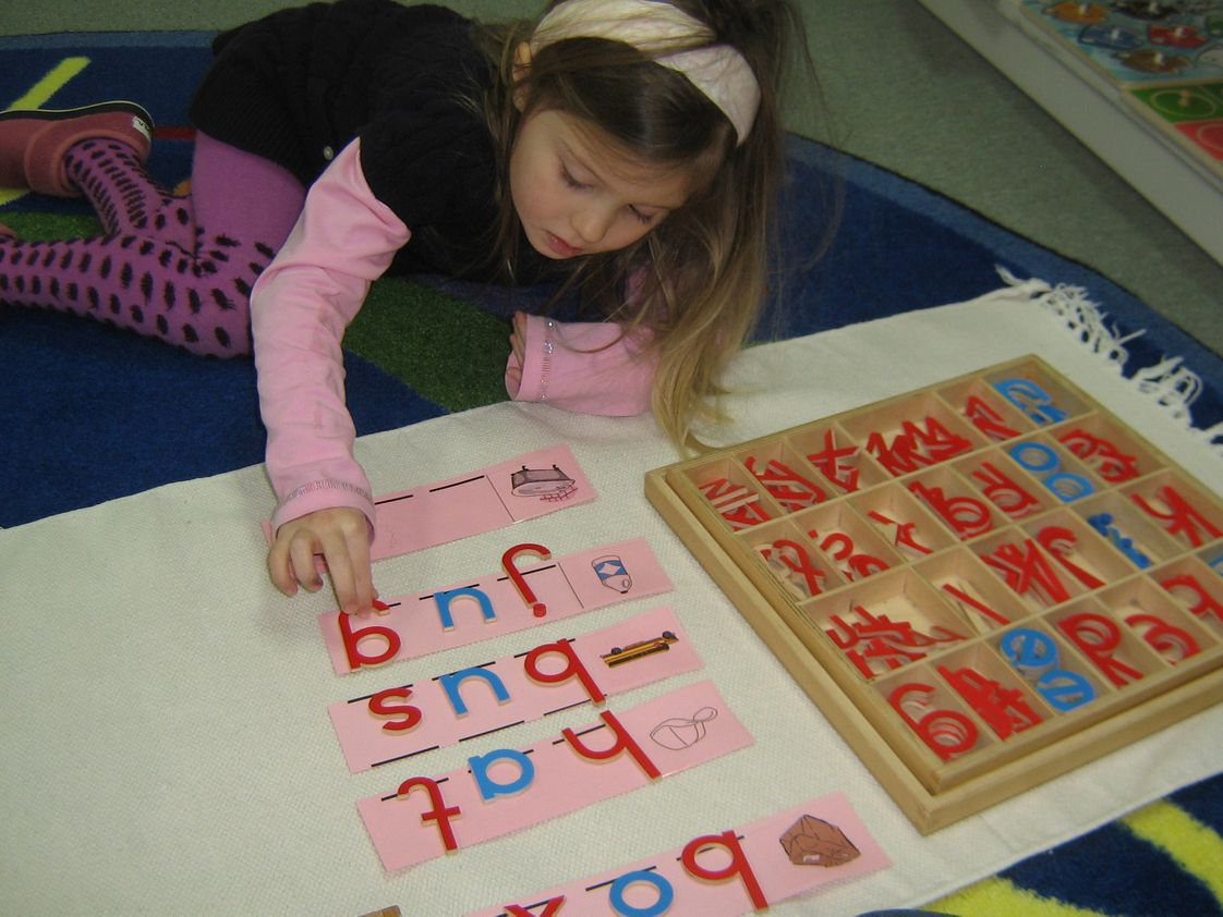 The Children's Tree Montessori School Photo - Learning to make words with the movable alphabet in the primary (preschool) classroom.