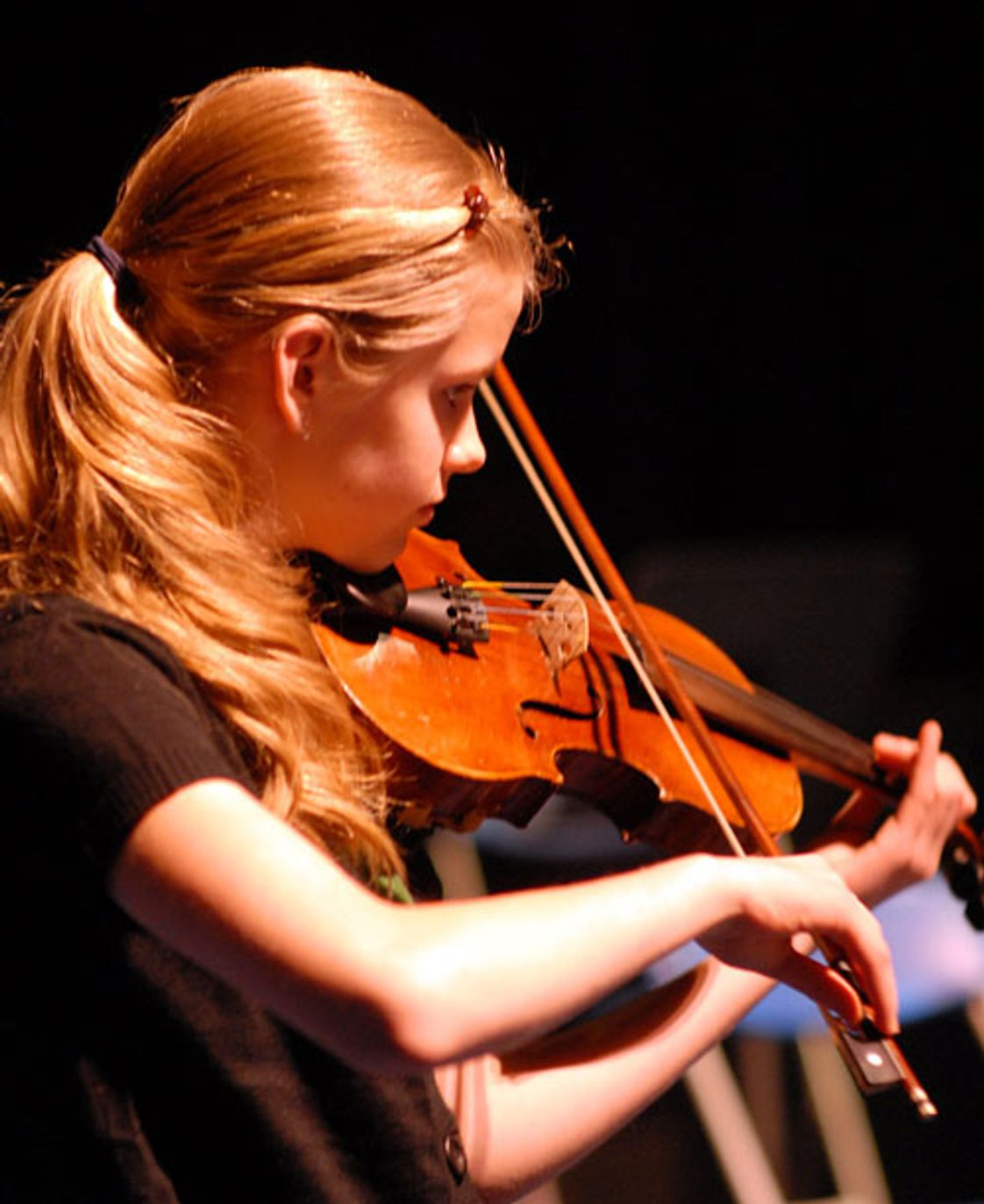 Stoneleigh Burnham School Photo #1 - An SBS student plays her violin during an on campus performing arts presentation.