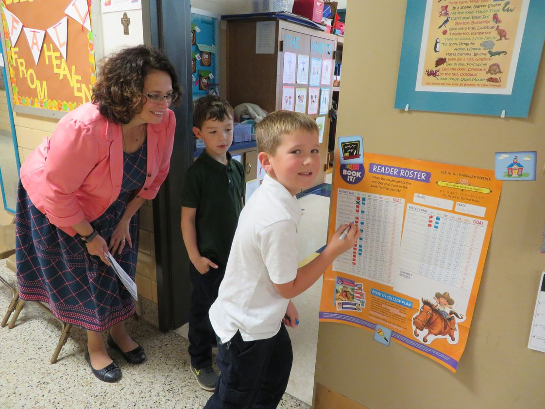 Holy Cross Catholic School Photo - Principal Reinhart helping a kindergarten student chart his goals. Holy Cross Catholic School, Defiance Ohio. #Greathappenshere!