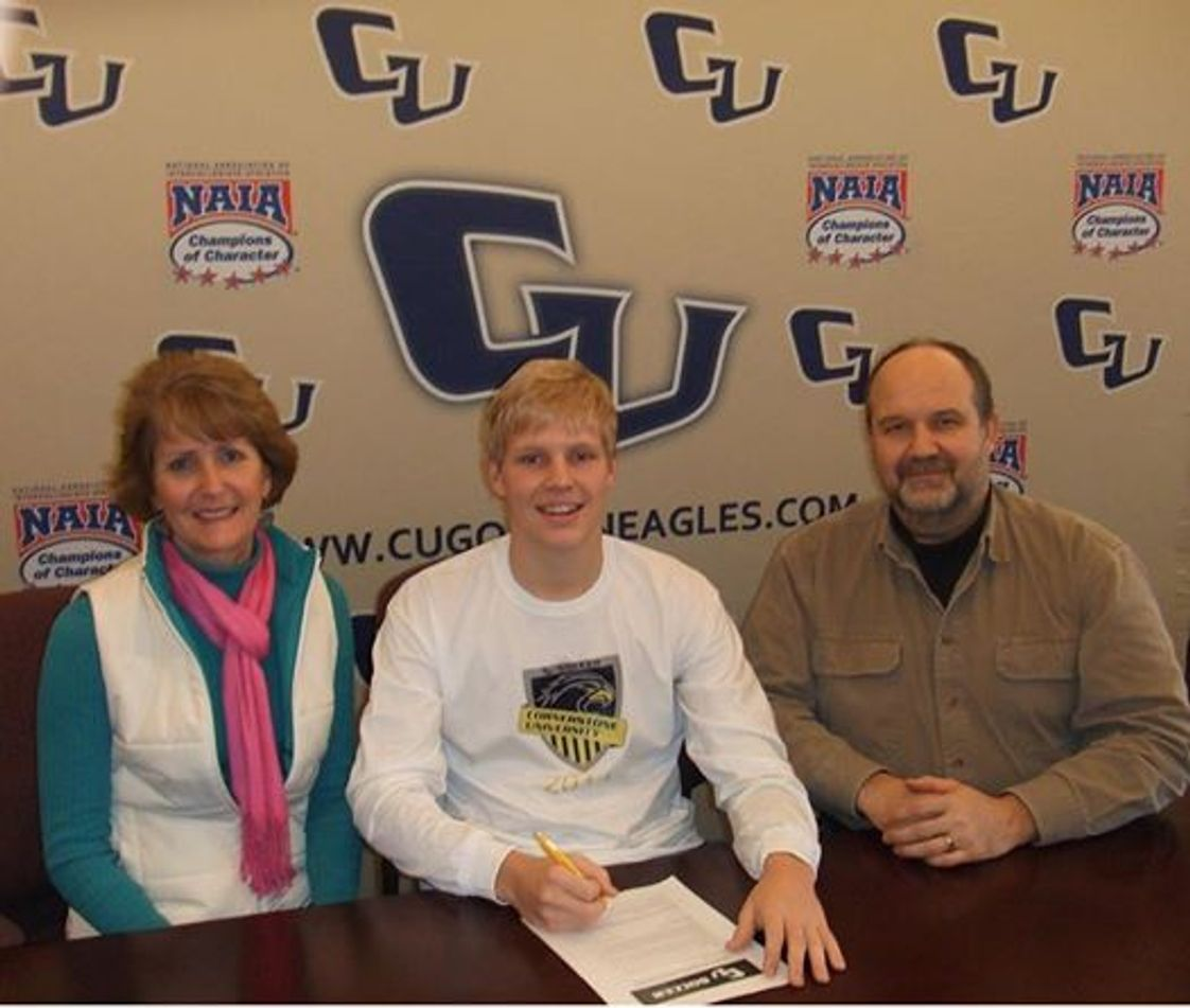 Victory Christian Academy Photo - Senior Evan Duey signs an athletic scholarship with Cornerstone University!