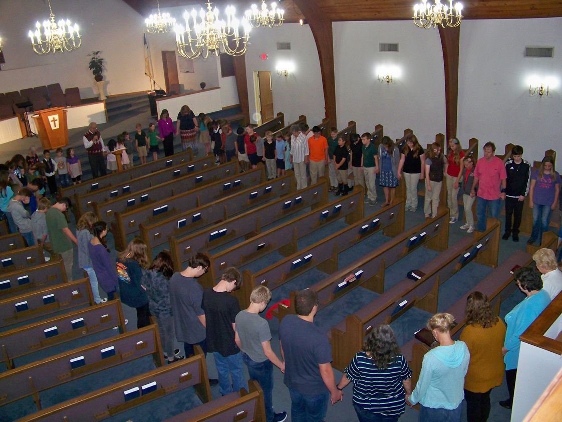 United Christian Academy Photo #1 - Prayer in the sanctuary.