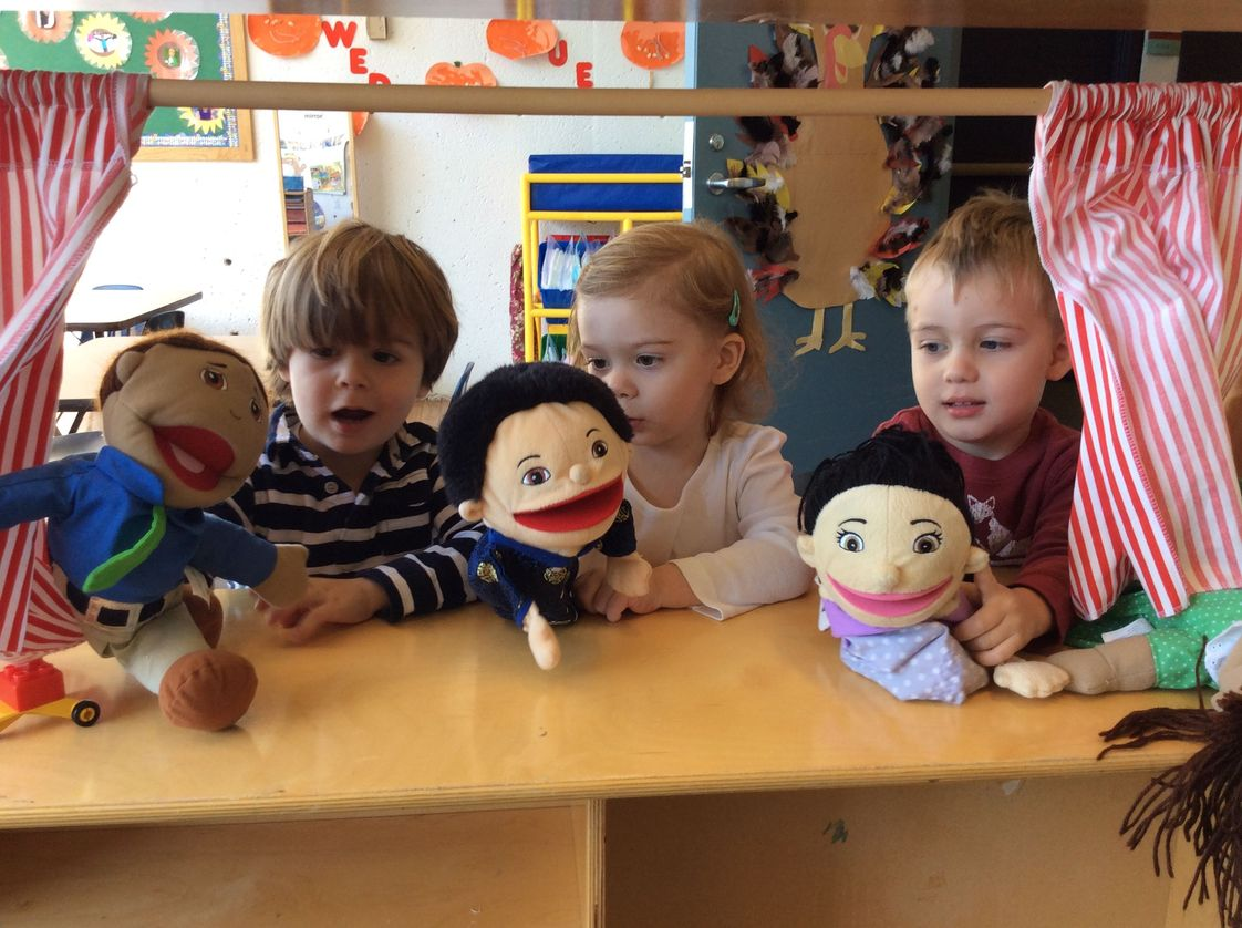 Park Street School Photo #1 - Toddler Transition friends put on a puppet show, acting out how to help a friend.