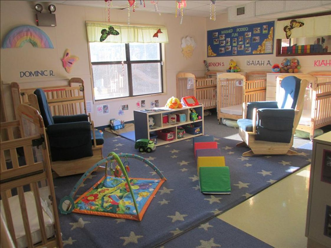 Cascade Park KinderCare Photo #1 - Our infant room is cozy and warm, bright and fun.