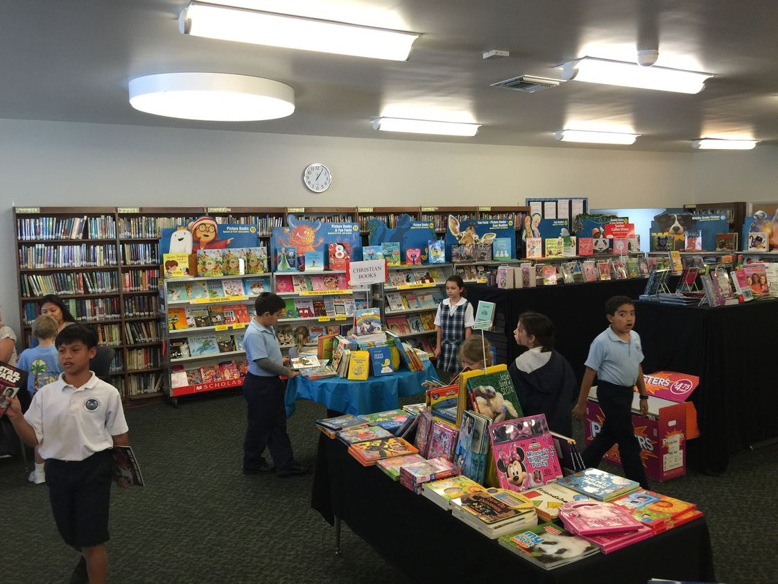Saint Jeanne De Lestonnac School Photo - Book Fair in Library/Media Center