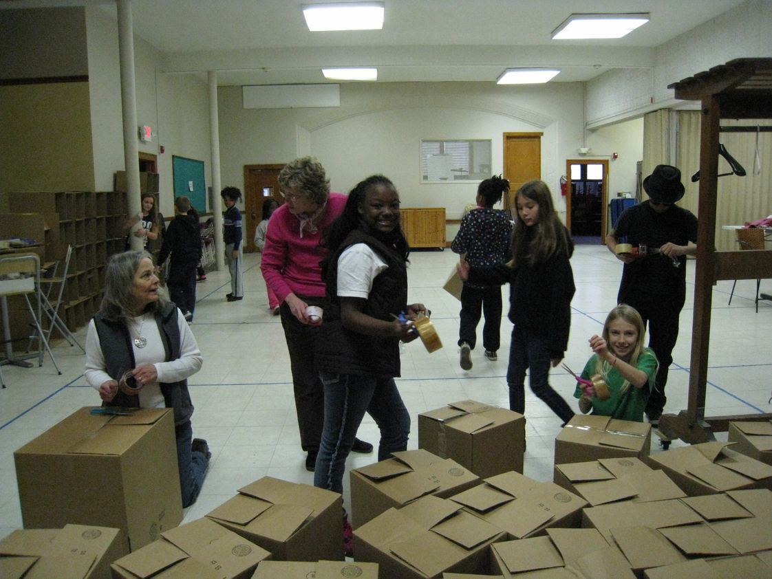 Charlotte Mason Community School Photo #1 - The 4th-8th graders helped put together boxes for the Boxes of Love food baskets for the needy.