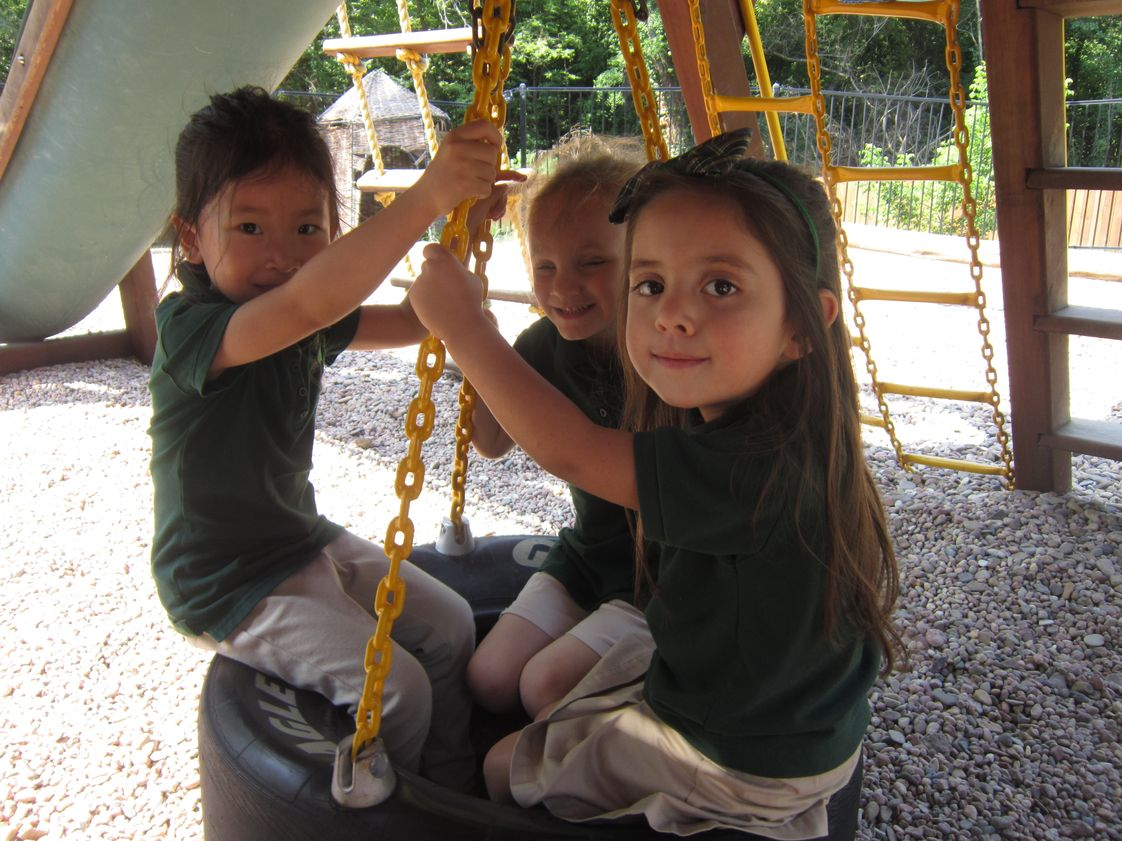 Honey Tree And Branches Academy Photo #1 - Having fun swinging outside.