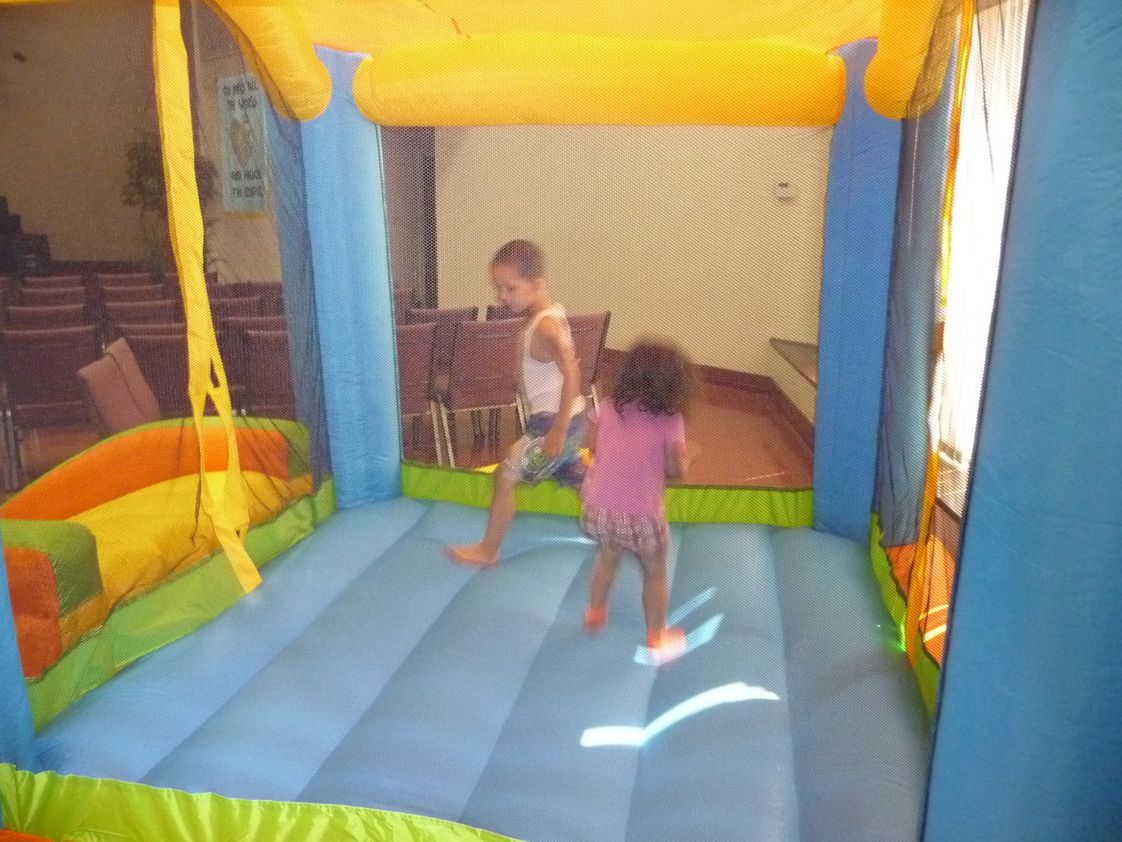 Grace Academy Photo - Children play in the bounce house at one of our preschool events.