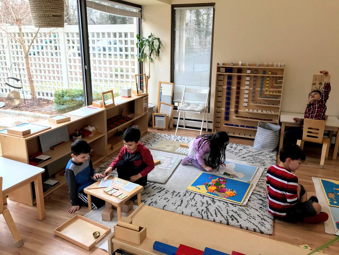 Willow Tree Montessori Photo - A glimpse inside the Casa math and geography area during the afternoon work cycle. Our multi-aged prepared environment supports the child's need to choose work, move freely, and repeat their work without interruption. This is AMI Montessori. You are invited to join us.