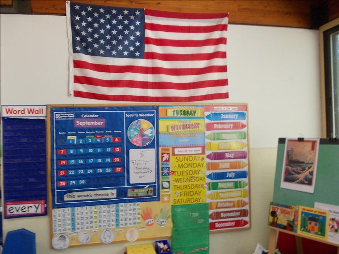 Manchester KinderCare Photo - Prekindergarten Classroom group and meeting area.