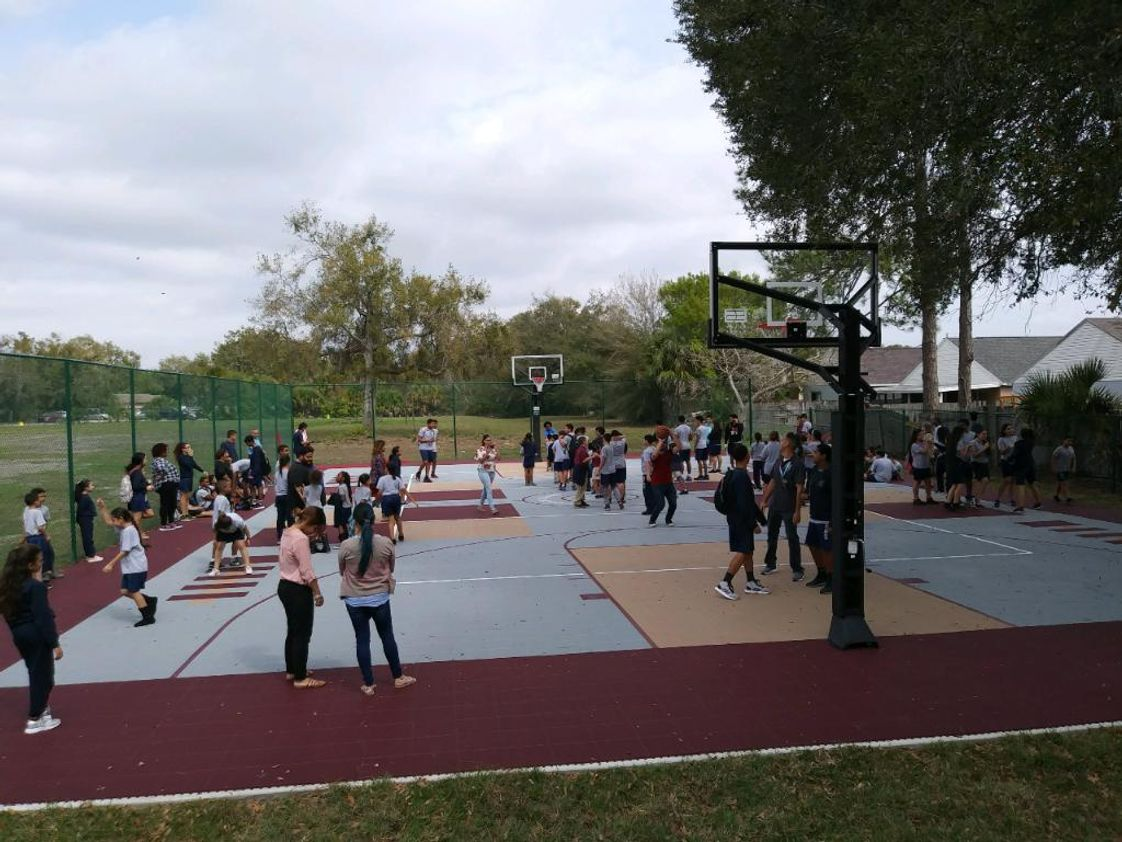 Azalea Park Baptist School Photo #1 - APBS completed the renovation of our outdoors sports court. The facility includes a basketball, volleyball courts and track.