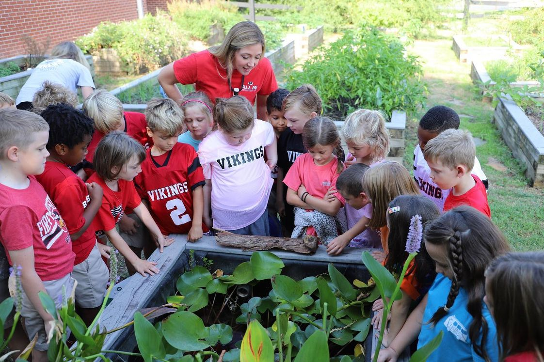 First Presbyterian Day School Photo - Second grade students study frogs and toads in our educational gardens.