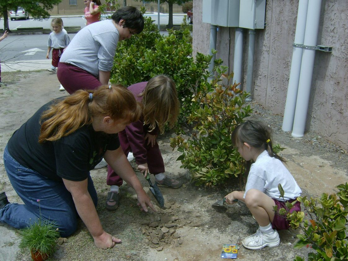 St Frances Cabrini Catholic School Photo #1 - Students and teachers beautify the campus as part of their Arbor Day activities, a joint effort between the upper schoo and the lower school.