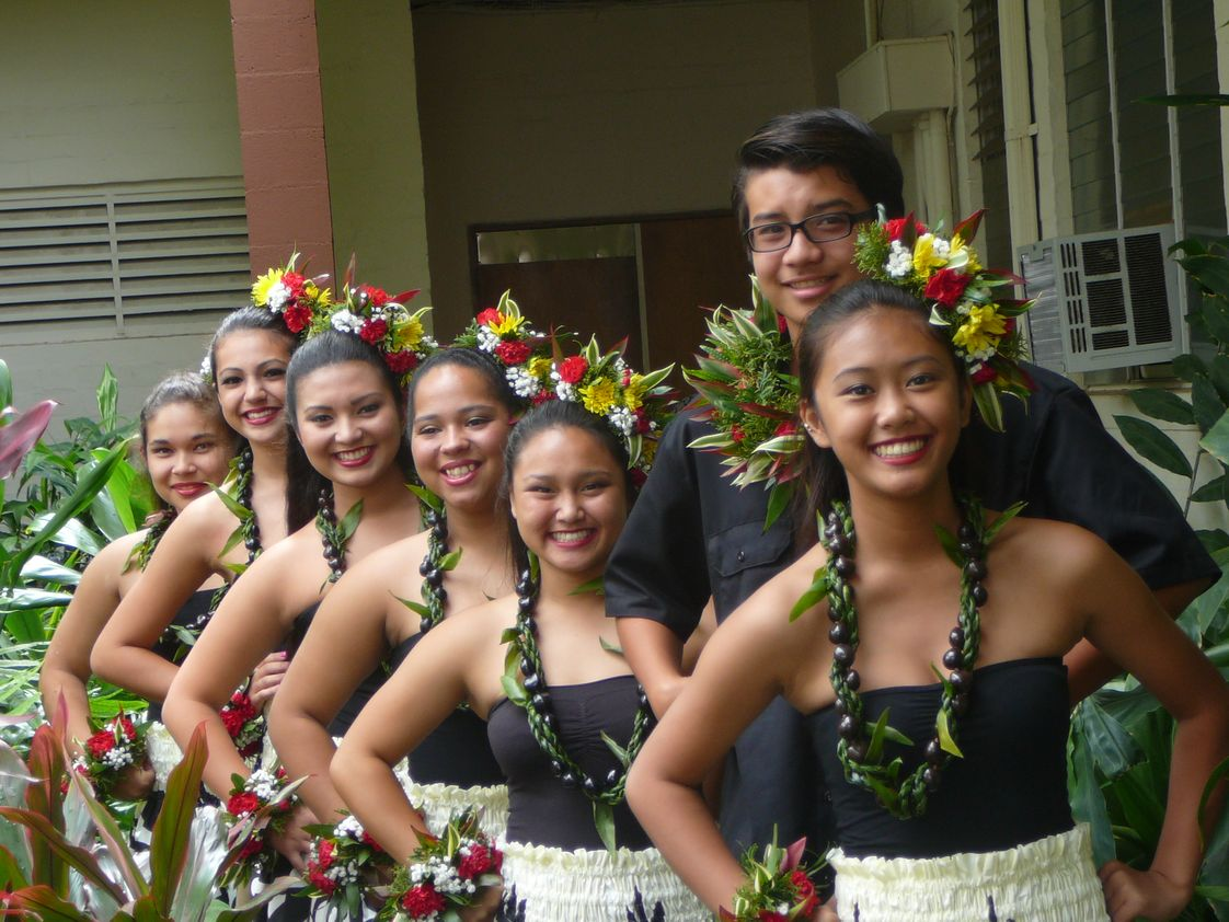 St. Francis School Photo #1 - Aloha Show is an annual program which includes grades K-12. We honor a King and a Queen from the Senior class. Many students share their talents performing with their classmates in the Royal Court. Here are some high school students after their Hula performance.