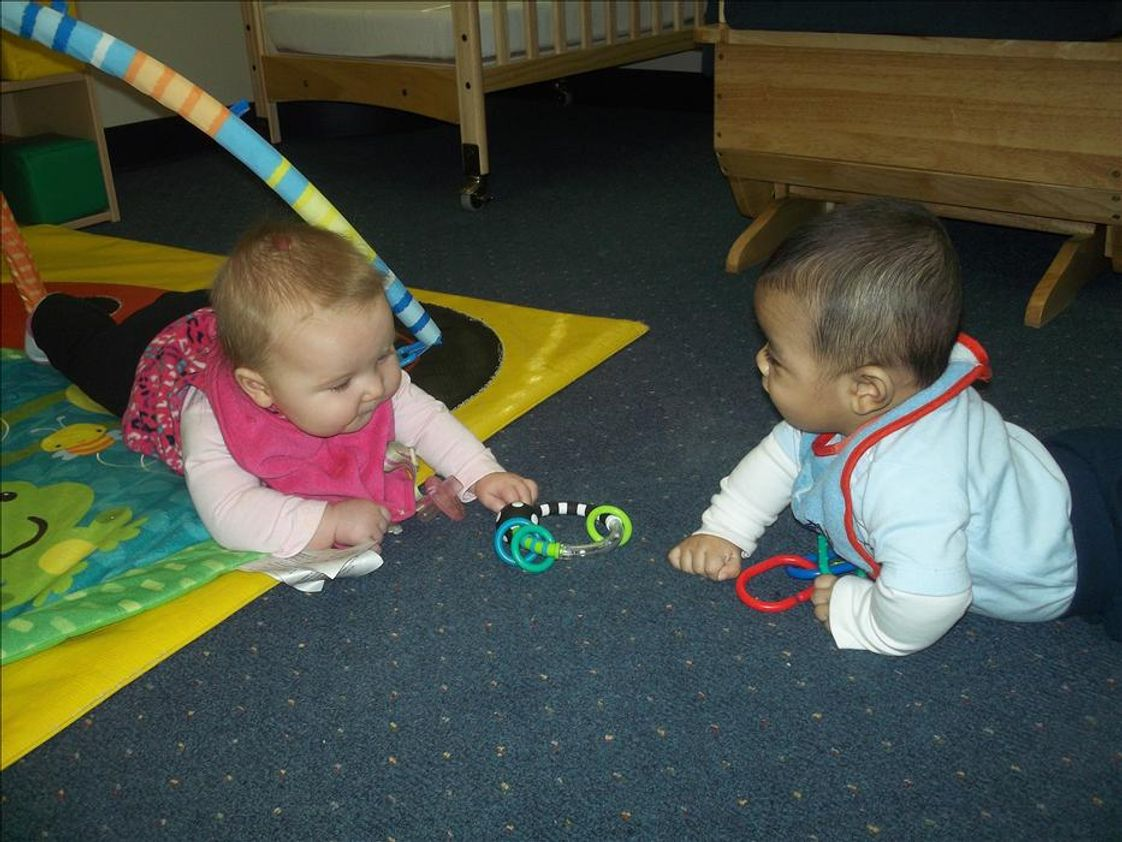 Westbrook KinderCare Photo - Messiah and Payton are enjoying tummy time together.