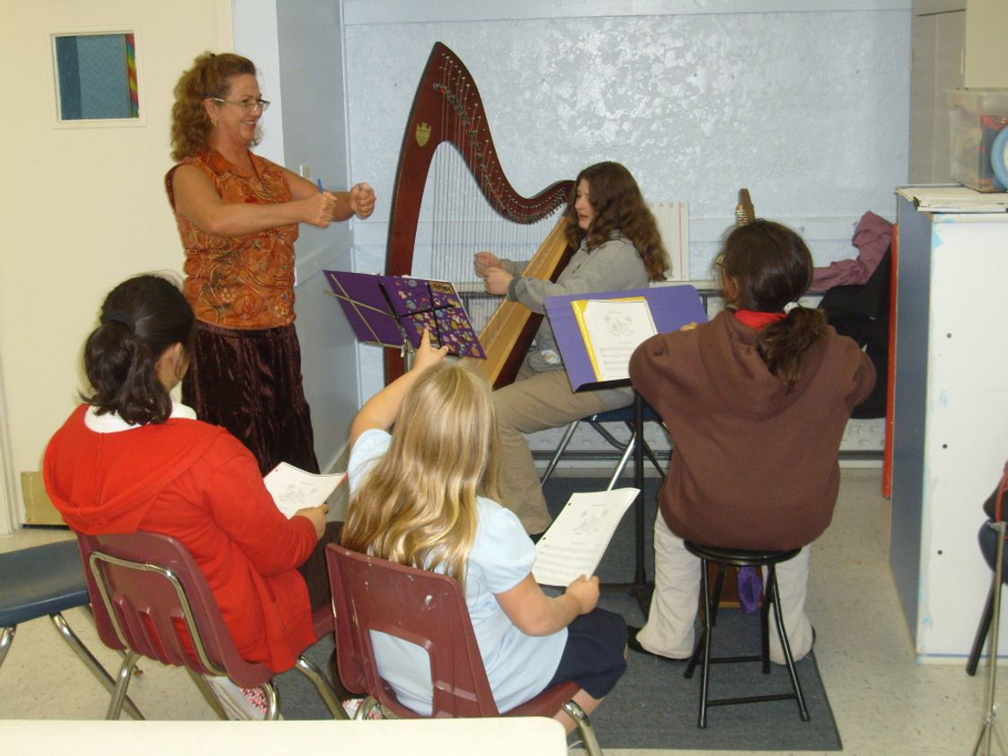Allegro Academy Photo #1 - Our harpists listen to instructor and Rockford Symphony harpist Ms. Felix.