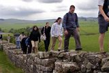 Students hiking Hadrian's Wall (built in 128 AD) in Northumbria, England