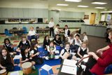 Second grade students taking part in music class - Lower School students take part in two enrichment classes each day. Options include Spanish, music, PE, technology, library, religion and art.