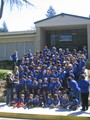 Pacific Union College Elementary School Photo - The whole student body on the front steps on a sunny spring day sporting new T-shirts commemorating one hundred years of educating children in Angwin.