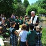 Christ The King Catholic School Photo - Our priest, Father Todd Riebe, blessing our new Sts. Isidore & Maria Garden.