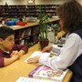 School Of The Incarnation Photo #5 - Students visit the school library with their class on a weekly basis.