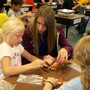 Christ Lutheran School Photo - Upper and lower grade students work together on art project.