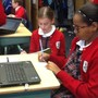 St Cecilia Cathedral School Photo #10 - Researching on the laptops for 6th grade Invention Convention assessment project.