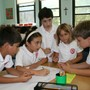 St. Stephen Of Hungary School Photo #4 - Students actively engage in collaborative small groups to develop problem solving skills, conflict resolution strategies, and their sense of independence.