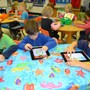 Fayetteville Academy Photo #3 - The Fayetteville Academy pre-kindergarten class use iPads to practice writing the alphabet.