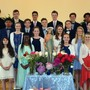 Our Lady Of Mercy Catholic School Photo - Eighth graders lead our school's annual May Crowning ceremony each May. Passing on the Christian faith is central to who we are.