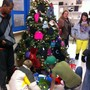 The Piedmont School Photo #2 - TPS Students place gloves and mittens on the tree for area families in need.