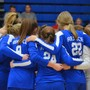 Rejoice Christian School Inc Photo #4 - The Lady Eagles Volleyball team prays together on the court before every match.