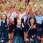 Our Lady Of Perpetual Help School Photo - Students rejoice in the autumn colors after a music class. Call us today to find out how your child can be a part of our family too!