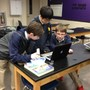 Prestonwood Christian Academy Photo #5 - PCA Middle School students engage in learning through use of a digital microscope.